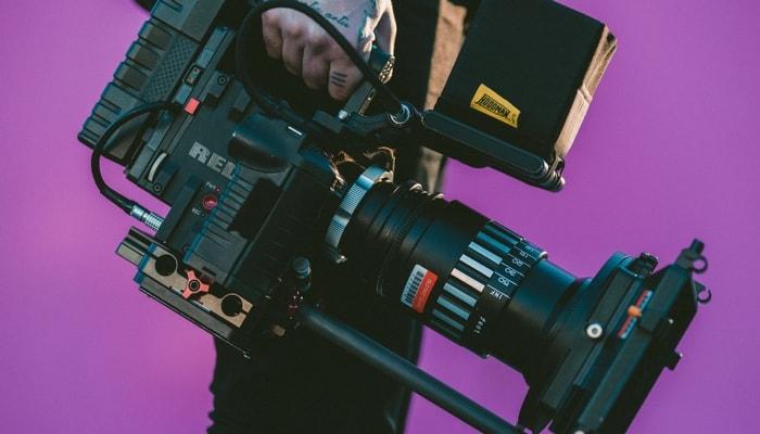 cameraman-purple-background-min