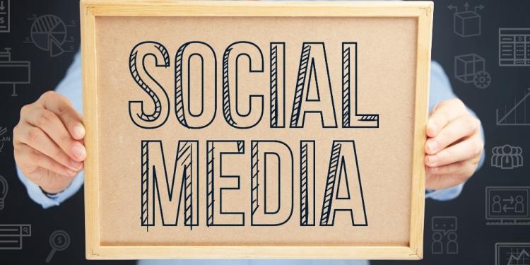 man holding social media sign