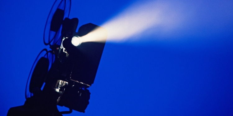 film projector with blue background
