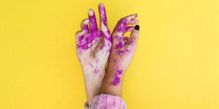 hands with pink glitter